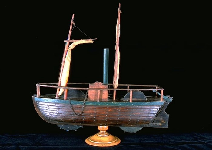 This model of the steamboat with its two masts, two paddle wheels, two rudders and funnel was made by James G Jeffs, a notable local artist/craftsman and a former curator of Dumfries Museum.